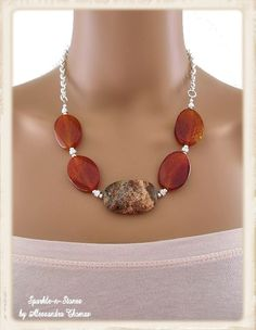 The Sophie Necklace - Accessorize with a bold pop of color around your neck! Polished red fire agate ovals compliment the African red agate center stone. This necklace makes a great accent for office ensembles or after-hours outfits!