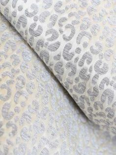 Snow Leopard Fabric in Silver and cream. Upholstery grade and available by the yard at www.tonicliving.com !