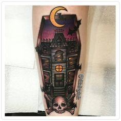hounted house tattoo coffin-shaped