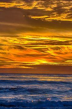 Golden turbulent sky at sunset - Hendry's Beach, Santa Barbara, California  (by Rob Laskin)
