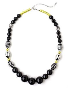 Exude adventure with our tribal-inspired necklace. Neon beads add a splash of interesting color. Pairs perfectly with our Tribal Terrain Earrings and Bracelet Set for a coordinating look. Complete with a lobster claw closure with extender. Customized in size and scale for the plus size woman. For your comfort, all Catherines jewelry is free of lead and nickel. catherines.com