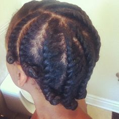 Flat twists and bantu knot on the ends. This will also work for several days after you take them down!