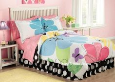 Eye Candy Flower Comforter Set . $89.99. Eye Candy is a bright flower pattern that brings luscious colors into any room. Fun, large flowers in fresh polka dots, prints, and solid colors of sky blue, sun yellow, violet, green and pink on a bright white background. The coordinating bedskirt displays a large black and white polka dot that's also on the comforter's reverse. The sheets are a solid pink circle print. This bedding is entirely made of Polyester -- the newest...