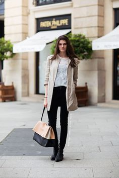 You have that tan coat like this and your black pants - cute top and shoes you can mix and match