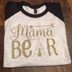Mama Bear TeePee Raglan Available in sizes Adult Small - Adult 2x. Please comment on which shirt you would like and what size you need and I will set you up your own listing!!!   These are made to order, most done within 2-3 days of order being placed, if it will be longer, I will notify you!    Thanks so much!!! Next Level Tops Tees - Short Sleeve