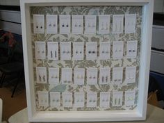 display for earrings..find those old large frames and repurpose them for a grand new life.