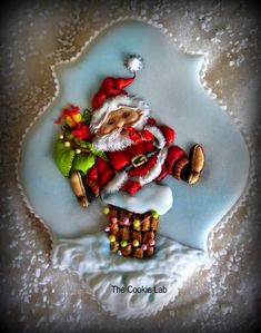 """The Cookie Lab by Marta Torres Coloured Royal icing Decorated Cookie - Not Painted """"Little Santa is ready to Jump down the chimney"""" (marina Fedotova inspired) Santa Cookies, Galletas Cookies, Holiday Cookies, Sugar Cookie Icing, Sugar Cookies, Spice Cookies, Cupcakes, Cupcake Cookies, Royal Icing Decorated Cookies"""