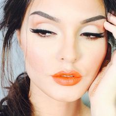 Eyes and orange lipstick. Perfect for spring 2014 where orange is on trend.