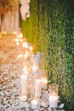 Light up your wedding night with romantic candles. | rose petals available at www.flyboynaturals.com One Love Photography