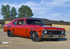 Billy Utley's super-hot 1972 Chevy Nova from B Classics with new Inferno Orange paint, additional engine bay bracing, a new set of JRI remote-reservoir shocks, hidden windshield wipers, and refreshed Forgeline ZX3R wheels with the bolt-on competition center caps.