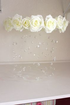This handmade flower mobile will make the perfect addition to your shabby chic, super girly, or princess room. Trust me its even more beautiful in person! Place the mobile anywhere in your baby girls nursery for that show stopping piece.  Handmade mobile with over 100 glass crystals, perfect addition to any room! The crystals are perfectly cut, so they sparkle and catch the light beautifully. This mobile can be made in different rose colors. Each crystal is hand strung in varying lengths…