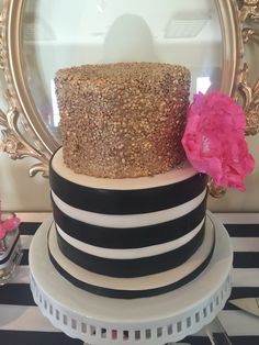 Kate spade inspired cake. Black and white stripes. Gold sequins and hot pink flower made by Jessica Mallari @jesscanbake