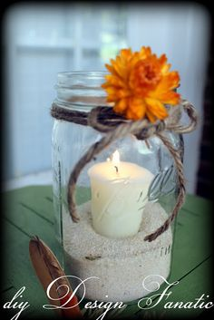 "Mason jar candle favor with sand, votive candle (in votive holder so the sand doesn't get yucked up) ribbon and flower. Sticker/tag saying ""Thank you for making our special day even brighter."" For the chicks at morning mimosa party. Boom. Done."