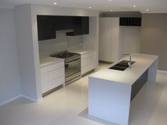 The Diamond Lily Kitchen with waterfall ends on the island bench and freestanding oven.