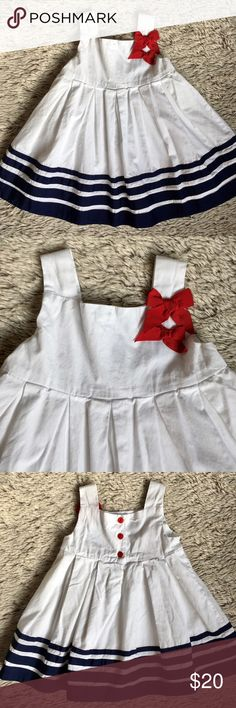 Adorable Dress ✨ Adorable cotton tank dress. Has 3 red buttons at the back. Navy blue grosgrain ribbon at the hem. In excellent condition. Perfect for 4th of July. Dresses