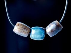 The blue black agate in this piece has the hues of the Pacific from navy to intense sea blue. It was carved from a single rare blue agate found