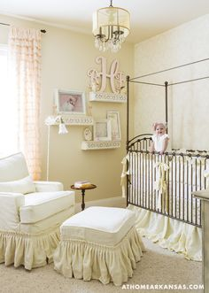 In 9-month-old Brooklyn's room, the crib and glider are from Kid's Furniture; custom bedding is from the Etsy shop Cottage and Cabin, and the glider is slipcovered in matching fabric. Sandpiper Studios wallpaper pairs with Sherwin-Williams' Barbados Sand paint.