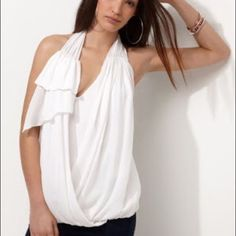 Bcbg Silk Draped Wrap Racerback Top Ivory Gorgeous bcbg wrap draped front top. Beautiful detail at front and button accents at back. Fully lined with a built in cami. Elastic waist for comfort. She'll is 100% silk and cami is 100% modal (feels like soft cotton). Size medium and fits true to size. In perfect condition. Purchased from another posher, but just doesn't suit me. please no trades, posh sales only BCBGMaxAzria Tops Blouses