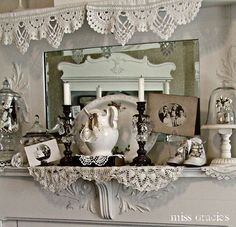 Fireplace mantle with vintage photos