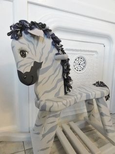 paint a old rocking horse into a zebra
