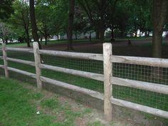 Keep the dog in!! Rustic cedar post & rail fence.  Supplied by Lanark Cedar