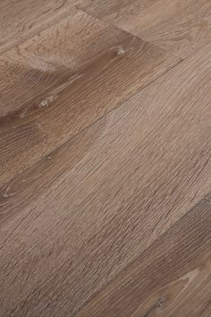 Double Smoked White. Bringing together light and depth, the result is a colour that's fresh yet restrained, deep but not serious. Chapel Parket wooden flooring.