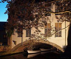 Floodlit building over a canal in Bruges, Belgium