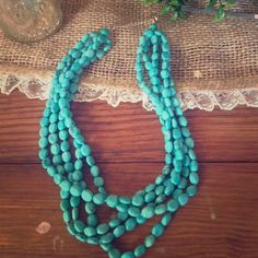 Turquoise 5 strand necklace Turquoise 5 strand necklace that goes with so much.  Turquoise is my color and I wear it with everything!   This is nice length and look without being to big or chunky.  Have enjoyed wearing this in all seasons. Jewelry Necklaces