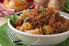 Turn your kitchen into an Italian restaurant with our easy version of the classic Rigatoni Bolognese. This hearty meat sauce packed with flavorful veggies over rigatoni pasta will do you proud! Pasta Recipes, Beef Recipes, Dinner Recipes, Cooking Recipes, Healthy Recipes, Hamburger Recipes, Restaurant Recipes, Easy Cooking, Delicious Recipes
