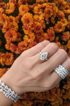 This three stone pear shaped diamond engagement ring is accompanied by a fabulous 4 row diamond fashion ring and triple stacked diamond tennis bracelets. #diamond #diamonds #threestone #engagementring #pear #pearshape #fashionring #diamondfashion #tennisbracelet #diamondring
