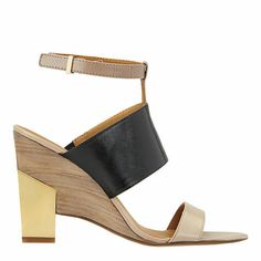 As seen in the February issue of O Magazine, our Neeway colorblocked sandal is detailed with an ankle strap and adjustable buckle closure. Padded footbed for all-day comfort. Leather upper. Man-made lining and sole. Imported. 3 3/4 inch heels with metal detail. Women's shoes. Colorblocked sandals.