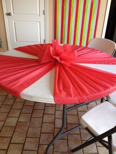 Cute way to put cheap plastic tablecloths on round tables. It would be really cute to use multiple colors.