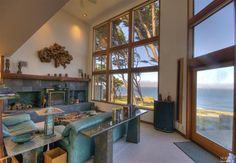 Jenner, CA // Living room with vaulted ceiling and over-sized windows to capture the ocean view.