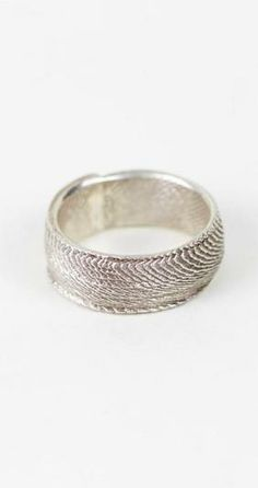 Channel your Paleozoic self with this delicate and bold silver ring, laced with a cuttlebone fish scale pattern.