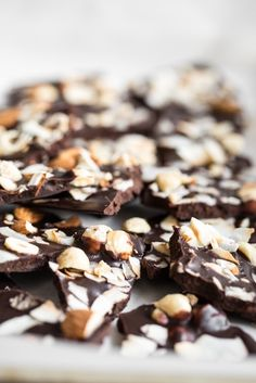 "Crazy Good Coconut Oil ""Chocolate"" Bark -- Ingredients:  1/4 cup raw hazelnuts 1/4 cup raw almonds 1/3 cup large flake dried coconut 1/2 cup virgin coconut oil 1/2 cup cocoa or cacao powder, sifted if necessary 1/4 cup pure maple syrup 1 tablespoon smooth almond butter, optional pinch fine sea salt"