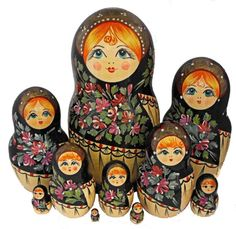 Collectible colorful set of ten nesting dolls is carved of bolsa wood