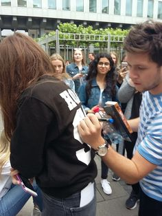 June 12: Niall with fans while doing Slow Hands promo in Germany