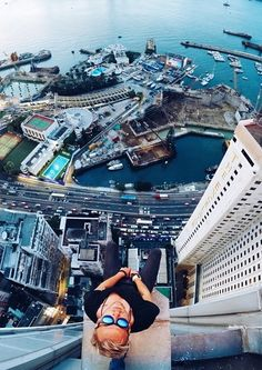 The trend, called Rooftopping, has thousands of photographers climbing to the top of the world's tallest skyscrapers for an unrestricted, bird's-eye view of the street below.