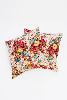 Quilted pillows in a bold floral pattern feel modern, not mom. #refinery29 http://www.refinery29.com/29-under-29-home-buys#slide-19
