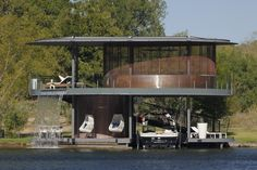 A round home with a lower-level boat dock. I think I found my retirement home :)