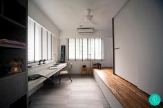 Lots of built-in carpentry to accommodate this long rectangular study room. Interior Designer: Project File