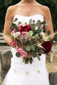 Create a rustic bouquet with greenery, scabiosa pods, pink roses, and marsala blooms. Photography: Jeannie Mutrais / Flower Duet. Read More: http://www.insideweddings.com/news/planning-design/marsala-wedding-ideas-inspired-by-pantones-color-of-the-year/2023/