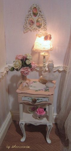The bedside table is hand made and hand painted by me, the lamp also. The roses are by Carol Wagner.