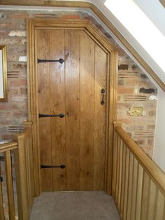 Made to measure bespoke oak internal door, pre finished and handcrafted by Heritage with matching stair rails.