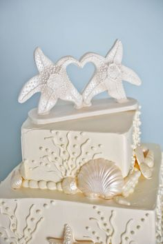 Starfish cake topper on this beautiful ocean themed wedding cake
