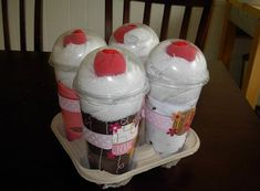 """Onesie Baby Shakes - Contains 4 Onesies, 4 Diapers, 8 White Wash Cloths, 4 red """"cherry"""" socks in clear cups with dome lid. How cute is that?!"""