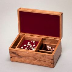 Intimate Jewelry box with a Cherry Body and a Vavona Redwood Burl lid. Size: 9 in wide, 5 1/2 in deep, 4 in high. Serial number: 0816-012-008  This box may be small, but we give it just as much care and craftsmanship as we give the larger boxes. From the little decorative keys in the corners to the rounded edge on the top, this box is as smooth, silky and warm as any box we make. We love making these boxes; theres just a wee small part of us in every box we make.  - Sliding box that holds…