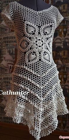 Inspiration only, there is not only no pattern at this link, but there is a picture of another crocheted dress. Also beautiful, and also, no pattern.  :(
