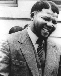 Mandela wearing a classic three piece suit. Forever an Icon #RIP