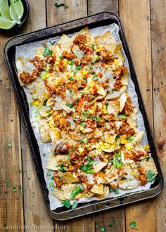 These Tequila Barbecue Chicken Nachos are absolutely perfect! Cheesy, crunchy, and packed with delicious flavors. http://mommyhoodsdiary.com